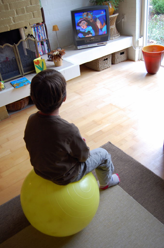 watching tv sitting on a ball