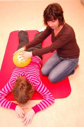 back massage for kid with ball